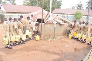 The Water Project: Nzeluni Girls Secondary School -  Filling Up Unprotected Water