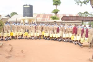 The Water Project: Nzeluni Girls Secondary School -  Students Lined Up With Water Containers