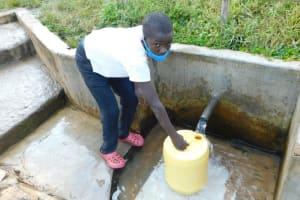 The Water Project: Sichinji Community, Kubai Spring -  Euginous Fetching Water