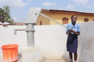 The Water Project: Sulaiman Memorial Academy Jr. Secondary School -  Student Joyfully Collecting Water
