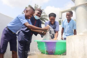 The Water Project: Sulaiman Memorial Academy Jr. Secondary School -  Students And School Supervisor Splashing Water