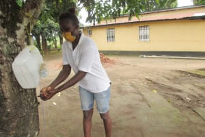 The Water Project: Lungi, Suctarr, #3 Lovell Lane -  Participant Demonstrating Handwashing With Tippy Tap
