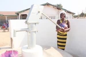 The Water Project: Kamasondo, Borope Village School -  Community Woman Collecting Water