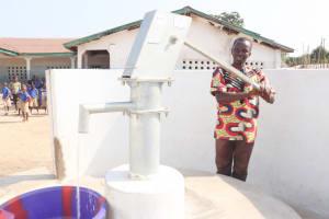 The Water Project: Kamasondo, Borope Village School -  Head Teacher Joyfully Collecting Water
