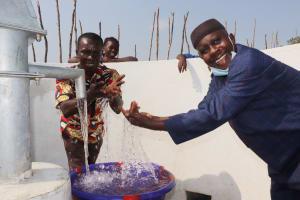The Water Project: Kamasondo, Borope Village School -  Head Teacher And Supervisor Of School Splashing Water