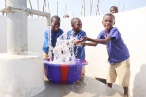 The Water Project: Kamasondo, Borope Village School -  Students Joyfully Celebrating And Splashing Water
