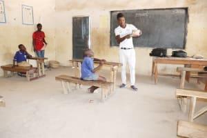 The Water Project: Kamasondo, Borope Village School -  Teacher Teaching Proper Way To Take Care Of The Teeth