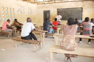 The Water Project: Kamasondo, Borope Village School -  Hygiene Facilitator Teaching About Bad Hygiene Pratice