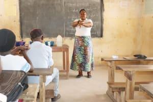 The Water Project: Kamasondo, Borope Village School -  Hygiene Facilitator Teaching About Proper Way Of Hand Washing