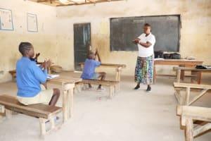 The Water Project: Kamasondo, Borope Village School -  Hygiene Facilitator Teaching About Proper Way To Hand Washing