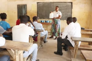 The Water Project: Kamasondo, Borope Village School -  Hygiene Facilitator Teaching About Tippy Tap And It Importance