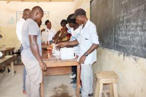 The Water Project: Kamasondo, Borope Village School -  Participants Constructing Tippy Tap