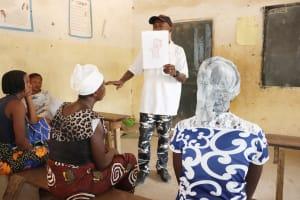The Water Project: Kamasondo, Borope Village School -  Teacher Teaching About Bathing
