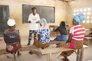 The Water Project: Kamasondo, Borope Village School -  Teacher Teaching About Clothes Line