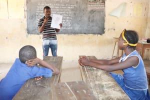 The Water Project: Kamasondo, Borope Village School -  Teacher Teaching Students About Bathingand It Importance