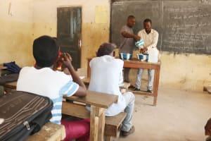 The Water Project: Kamasondo, Borope Village School -  Teachers Demonstrating One Of The Hand Washing Method