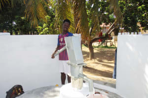 The Water Project: Lungi, Suctarr, #1 Kabbia Lane -  Community Member Collecting Water After Installation