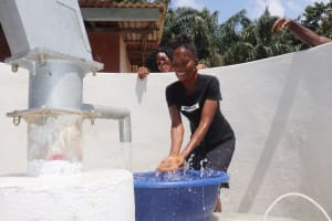 The Water Project: Lungi, Suctarr, #1 Kabbia Lane -  Woman Joyfully Splashing Clean Water