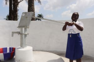 The Water Project: Lungi, Tintafor, St. Augustine Senior Secondary School -  Student Happy Collecting Water