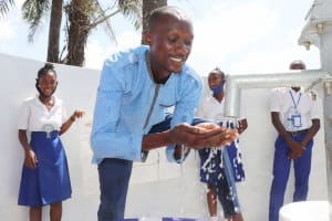 The Water Project: Lungi, Tintafor, St. Augustine Senior Secondary School -  Teacher Joyfully Playing With Clean Water