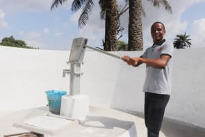 The Water Project: Lungi, Tintafor, St. Augustine Senior Secondary School -  Teacher Collecting Water After Installation