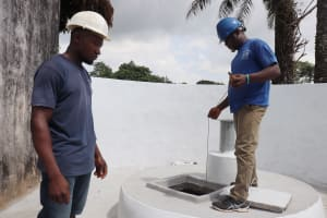 The Water Project: Lungi, Tintafor, St. Augustine Senior Secondary School -  Checking Well Depth And Static Water Level