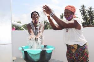 The Water Project: Lokomasama, Conteya Village -  Community Members Celebrating And Splashing Water