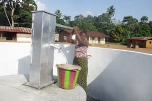 The Water Project: Lokomasama, Conteya Village -  Community Member Collecting Water After Installation