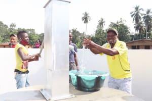The Water Project: Lokomasama, Conteya Village -  Councilor Paul Dixion Rejoicing And Splashing Safe Drinking Water