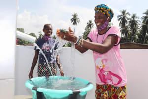 The Water Project: Lokomasama, Conteya Village -  Woman Joyfully Splashing Water