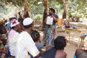The Water Project: Lokomasama, Conteya Village -  Hygiene Facilitator Teaching About Tippy Taps
