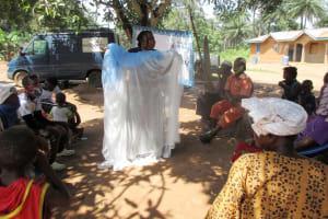 The Water Project: Lokomasama, Rotain Village -  Teaching Importance Of Using Mosquito Nets
