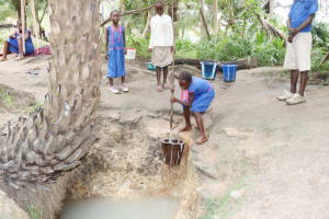 The Water Project: St. Peter Roman Catholic Primary School -  Pupil Collecting Water