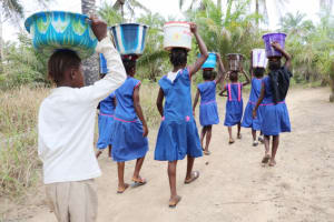 The Water Project: St. Peter Roman Catholic Primary School -  Pupils Carrying Water