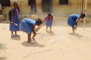 The Water Project: St. Peter Roman Catholic Primary School -  Pupils Cleaning School Compound