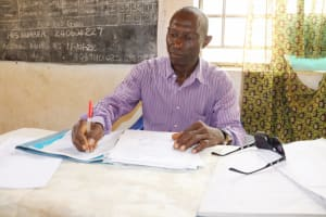 The Water Project: St. Peter Roman Catholic Primary School -  School Principal Inside His Office