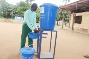 The Water Project: DEC Kitonki Primary School -  Student Demonstrating Handwashing