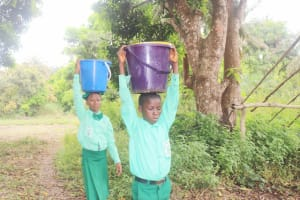 The Water Project: DEC Kitonki Primary School -  Students Carrying Water