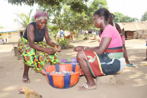 The Water Project: Lungi, Yongoroo, 32 Gbainty Bunlor -  Women Cleaning Up Fishes