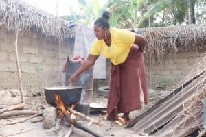The Water Project: Lokomasama, Kalangba Junction, Next to Alimamy Musa Kamara's House -  Woman Cooking
