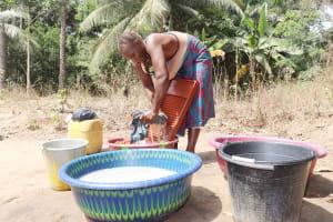 The Water Project: Lokomasama, Kalangba Junction, Next to Alimamy Musa Kamara's House -  Woman Laundering