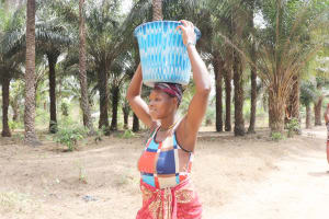 The Water Project: Lokomasama, Kalangba Junction, Next to Alimamy Musa Kamara's House -  Woman Carrying Water