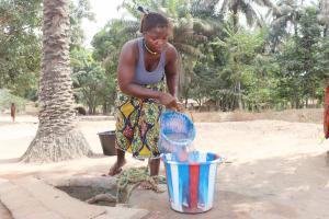 The Water Project: Lokomasama, Kalangba Junction, Next to Alimamy Musa Kamara's House -  Woman Collecting Water