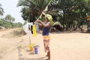 The Water Project: Lokomasama, Kalangba Junction, Next to Alimamy Musa Kamara's House -  Woman Hanging Clothes