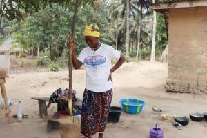 The Water Project: Lokomasama, Kalangba Junction, Next to Alimamy Musa Kamara's House -  Woman Pounding Cassava Leaves