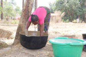 The Water Project: Lokomasama, Kalangba Junction, Next to Alimamy Musa Kamara's House -  Woman Processing Native Oil