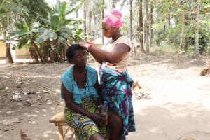 The Water Project: Lokomasama, Kalangba Junction, Next to Alimamy Musa Kamara's House -  Young Girl Plaiting Hair