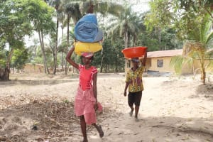 The Water Project: Lokomasama, Kalangba Junction, Next to Alimamy Musa Kamara's House -  Women Carrying Goods From Farm