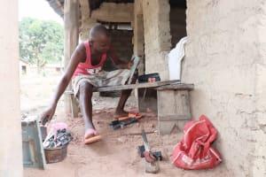 The Water Project: Lokomasama, Kalangba Junction, Next to Alimamy Musa Kamara's House -  Young Man Repairing Radio