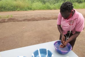 The Water Project: Lungi, Suctarr, #3 Lovell Lane -  Participant Demonstrating One Of The Handwashing Methods